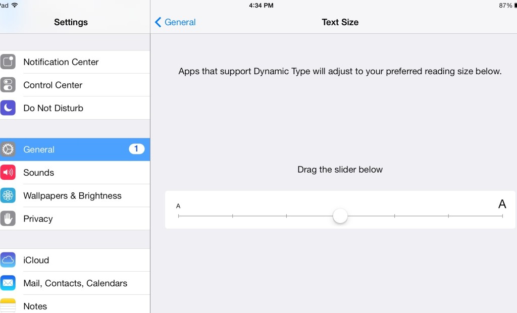 Head over to settings, then general to expose the text size slider.
